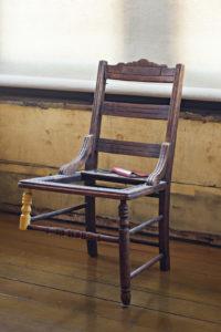 David Ireland, Three-legged Chair, 1978, Wood chair, journal and metal chain