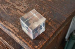 Virginia Overton, Untitled (Duchamp, Ireland, Overton), 2017; Acrylic photo cube and portraits