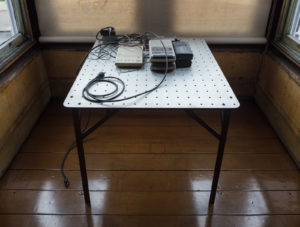 David Ireland, Getting to Know as Many People as You Can, 1986-90; Metal table, cassette recorders, telephone answering machine, power strip, painted wood block