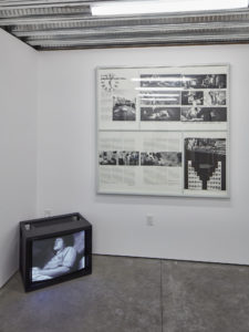 (Left) Howard Fried, Which Hunt?, 1972, Single-­‐channel video with sound, 38 min. Performance with 15 participants for videotape on May 25, 1972, San Francisco Art Institute, Courtesy the artist and The Box, Los Angeles. (Right) Howard Fried The First Prototype for a Clock of Commercial Significance, 1978 Photographs mounted on board, clock movement, painted clock hands, painted wood, and glass, Courtesy the artist and The Box, Los Angeles