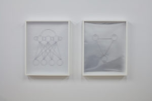 (Left) Brian Moran Untitled (from Engineering Consent), 2017, Permanent marker on drafting vellum, acrylic lenticular lens sheet, Courtesy the artist and Galerie Gregor Staiger. (Right) Brian Moran, Untitled (from Engineering Consent), 2017, Permanent marker on Mylar, acrylic lenticular lens sheet, Courtesy the artist and Galerie Gregor Staiger
