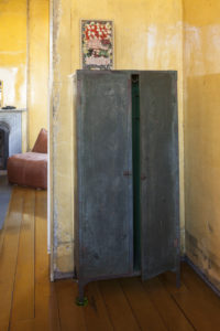 David Ireland, Cabinet with Partially Opened Door with Painting by Roy Deforest, 1978-1988, Painted metal, acrylic painting on wood, glass