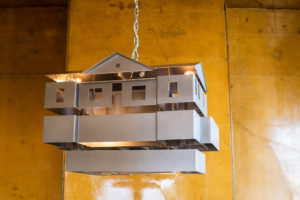 """Mike Kelley """"Mobile Homestead Swag Lamp Edition"""", 2010-2013. Aluminum, steel, lighting fixtures, wiring.  Courtesy of the Mike Kelley Foundation for the Arts"""