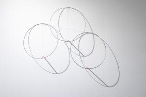 Felipe Dulzaides, Circular Fragility, 2011. Graphite, three metals rings, nail and pencil.
