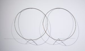 Felipe Dulzaides, Split Ends, 2011. Graphite, two metals rings, nail and pencil.